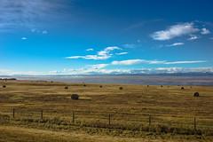 Hwy. 1A Bow Valley vistas, (Image 1) (Martin Thielmann) Tags: ab bowvalley rockymountains fenceline fogdissipatingovervalley haybalesdottingfield nearcalgarycitylimits vistafromoldbanffhwy
