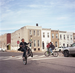 (Josh Sinn) Tags: street friends boy color 120 6x6 film bike bicycle mediumformat kid md kodak maryland baltimore neighborhood 100 wheelie yashicamat124g ektar joshsinn
