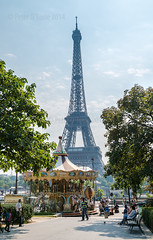 Eiffel Tower in Paris, France with a Merry-Go-Round in the Foreground (peterotoole) Tags: city travel vacation sky urban white black paris france detail tower history tourism monument beautiful grass architecture vintage french outdoors high europe european day arch tour view place symbol outdoor antique background steel famous capital scenic landmark carousel eiffel tourist structure historic retro entertainment destination romantic merrygoround parisian attraction destinations