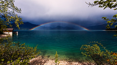 Rainbow Theatre (One_Penny) Tags: light sky lake mountains tree nature colors leaves rain clouds canon germany landscape bayern deutschland bavaria photography see rainbow colorful oberbayern shore walchensee 6d