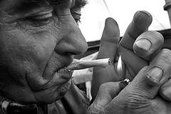 Albania - Tirana (luca marella) Tags: street portrait people bw white man black fire blackwhite cigarette documentary social pb bn smoking bianco nero reportage marellaluca