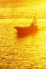 fisherman in fishing boat at sunset (Mimadeo) Tags: ocean light sunset sea orange sunlight fish reflection nature water silhouette yellow sunrise landscape outdoors gold golden evening boat fishing fisherman ship dusk hobby boating sail nautical fishingboat
