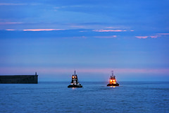 tugboats at evening (Mimadeo) Tags: ocean sunset sea sky water night port evening harbor boat ship vessel assist maritime tugboat tug nautical tugboats assistant