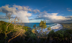 Rainbow Clouds - Byron Bay (dazza17 - DJ) Tags: panorama sun beach clouds boats shower coast rainbow surf coastline sunshower hdr byronbay