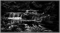 6763SE The Middle Cascade (foxxyg2) Tags: longexposure bw water mono blackwhite yorkshire cascades northyorkshire swaledale crackpotfalls niksoftware waterfalle silverefex