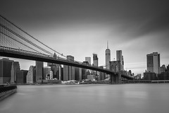 Brooklyn Bridge ([~Bryan~]) Tags: brooklynbridge brooklyn bridge bw monochrome nd ndfilter longexposure city cityscape nyc newyorkcity manhattan wtc worldtradecentre daytimelongexposure building architecture urbanlandscape skyscraper us newyork lowermanhattan