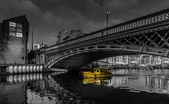 Water taxi in Leeds (Jo Hernandes) Tags: taxi water yellow bw blackandwhite color city leeds england uk sky canal boat bridge blackwhite supershot
