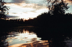 6.2016 Lake Sullivan C41 Cannon PS E33 (Jcicely) Tags: 2016 c41 canonfilmpointandshoot clouds easternwashington june kayaking loonlake loonlakewithmarvin passageway reflection shadow sky sunset trees water