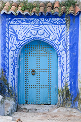 A nicely decorated door in Chefchaouen Medina (adventurousness) Tags: bluecity chefchaouenthebluepearl thebluecity blue chaouen chefchaouen door morocco travel