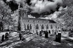 The Parish Church of St.James, Spislby (David Feuerhelm) Tags: outdoors nikkor building church tower windows cemetery graves tombstomes gravestones bricks trees sky clouds bw blackandwhite monochrome contrast wideangle infrared silverefex spilsby lincolnshire england nikon d90 noiretblanc