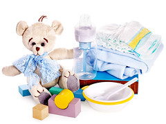 Baby diaper and toys with teddy bear . (pepsul) Tags: toy teddybear cubes blocks baby kid child diaper dish plate spoon babybottle stilllife stuffed soft concept object isolated onwhite nobody childhood closeup lifestyle play group development young playing construction learn game leisure various nopeople collection yellow playthings stuffedtoy softtoy book nappy bottle nipple pacifier fairytales