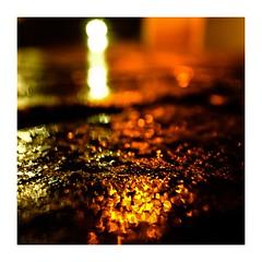 wetcobbled (seba0815) Tags: ricohgrdiv grdiv color black yellow light lights neonlights reflection water rain road cobbled wetcobbled bokeh abstract surreal dark darkphotography mood night nightfoto street streetphotography streetlamp shining seba0815 square availablelight urbanarte