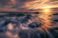 Rocky Waters (lonekheir) Tags: ocean sea archipelago norge norway waves water sunset sun rocks shore shoreline light colors clouds