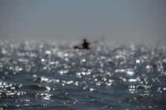 Canoe Slide (pogmomadra) Tags: boat canoe rowing sea bokeh sliderssunday hss