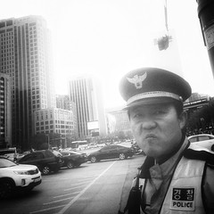 No time to say cheese (brendan  s) Tags: people creative streetphotography korea kimchi koreans saycheese iphone urbanphotography streetportraits smileplease mobilephotography koreanlife appleiphone iphone5 iphonephotography seoulpolice iphoneart livelearnlove shotonaniphone iphoneography shotoniphone appleiphonephotography iphonestreetphotography brendan tryingtoseewhatcanbeseenandhowtoseeit photographicpunctuation mobiography bravephotography iphunography brendans thingstodoinseoul nottimetosaycheese seoulpoliceman brendansiphoneography brendansiphunography brendansmobilephotography brendansiphonephotography