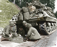 M 10 tank destroyer crew plays craps while waiting for a road block to be removed, 4 Dec 1944