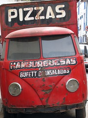 Pizza truck in Cusco (pburka) Tags: red food peru cuzco cusco wheels transport headlights hamburgers pizza saladbar foodtruck silverorange:id=203390