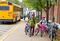 Kids Biking to School on Internation Walk and Bike to School Day (Dasha Rosato Photography) Tags: family pink blue school boy people usa building male sports students girl fashion bike bicycle kids female arlington america children person bicycling cycling virginia us student education publictransportation unitedstates exercise masculine feminine events unitedstatesofamerica transport helmet luggage safety event pack health cycle elementaryschool transportation backpack knowledge northamerica recreation schools schoolbus crosswalk fitness instruction pupils zebracrossing hotpink northernvirginia packs outdoorrecreation exercising healthiness selfimprovement keyschool landtransportation erudition francisscottkey sportsrecreation edification francisscottkeyelementaryschool greeningofamerica escuelakey internationalwalkandbiketoschoolday nationalbiketoschoolday bikeandwalktoschoolday