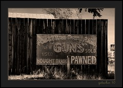 Powder Horn Guns (the Gallopping Geezer 2.5 million + views....) Tags: building abandoned sign wall canon decay painted motel structure faded worn signage weathered wyoming decayed geezer 2010 corel ghostsign shoshoni