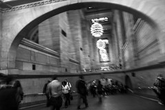 Rush. (Ian's) Tags: nyc people newyork lamp arch walk busy grandcentralstation