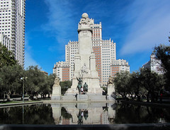Cervantes Monument (Jocey K) Tags: madrid city trees sky people sculpture building water architecture clouds buildings reflections pond spain skyscrapers stature donquixote plazadeespaa bronzesculptures cosmostour tourtoeuropeinseptnov2012 sculpturesofdonquixoteandsanchopanza