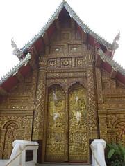 More beautiful Buddhist art on this wat as well (oldandsolo) Tags: thailand southeastasia buddhism chiangmai wat highstreet buddhisttemple norththailand buddhistshrine buddhistreligion watsrisuphan chiangmaistreet buddhistfaith silverubosot chiangmaitraffic downtownchiangmai