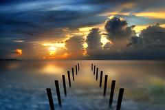 The Pier that Was (Carlos Gotay Martnez) Tags: sunset sea sky clouds coast pier horizon lanscape waterscape