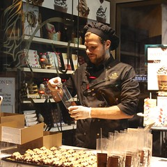 Chocolate Shop (Read2me) Tags: she light man window shop night work store candid bigmomma challengeyouwinner friendlychallenges thechallengefactory superherowinner pregamewinner gamesweepwinner challengeclubwinner