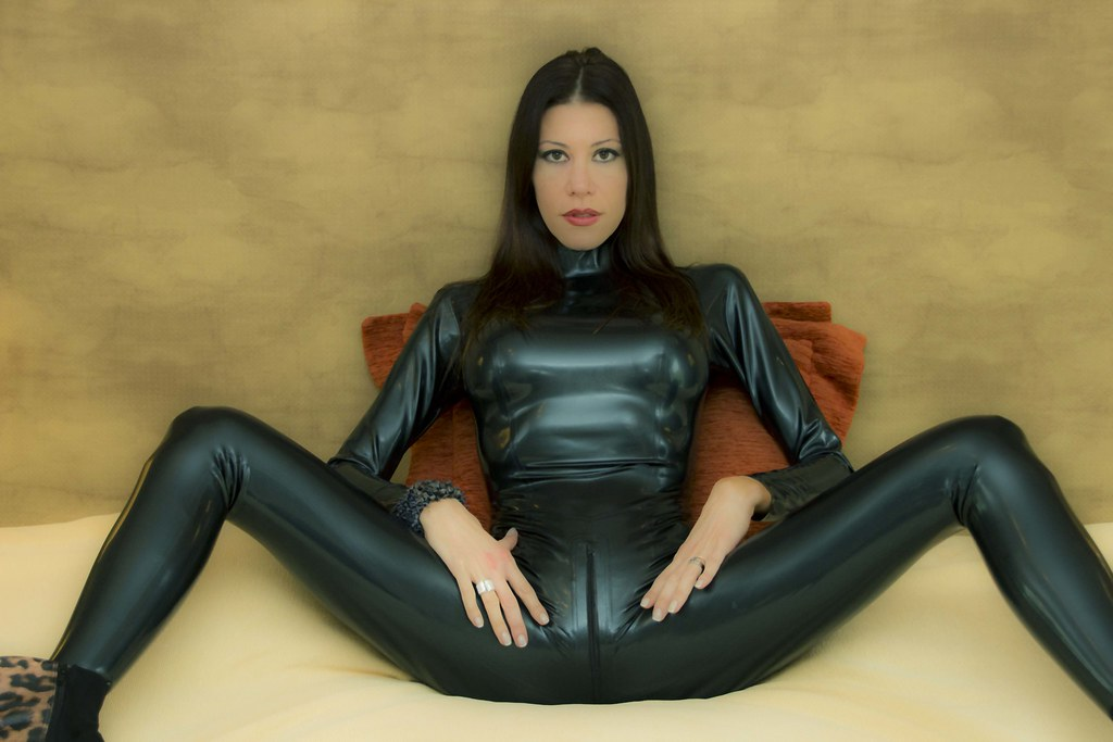 Blonde in latex suit reveals her fit body 9