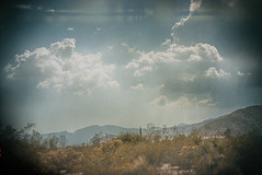 There's A Cloud Over Your Head (hbmike2000) Tags: california cactus sky usa cloud mountain mountains clouds landscape nikon desert fluffy highdesert d200 hdr sunflare morongo sanbernardino morongovalley hcs desertclouds clichesaturday hbmike2000