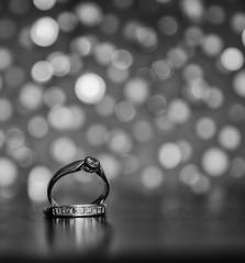 Twenty... (Go placidly amidst the noise and haste...) Tags: rings ring bokeh mono blackandwhite dof depthoffield silverefex diamond diamonds gold eternity engagement jewelery blackwhitepassionaward