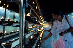 Little Flames (alisdair jones) Tags: ef35mmf14lusm flames fire candles devotees worshippers buddhist ruwanwelisaya anuradhapura srilanka