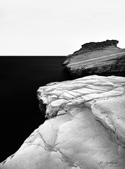 White Stones (Alex Apostolopoulos) Tags: blackandwhite longexposure bw fineart rocks sea seascape stones monochrome white cyprus sony sonya6000 ilce6000 samyang samyang12mmf20ncscs haidafilters manfrottobefree
