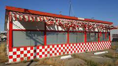 A CHECKERED PAST (akahawkeyefan) Tags: restaurant closed defunct selma davemeyer awnings tattered