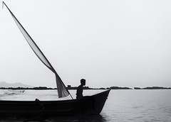 Early at work, before the chaos. (swearingpirate) Tags: boatman boat ocean morning india bnw blackandwhite silhouette