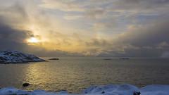Hail-O ye winter sun :)) (lunaryuna) Tags: norway lofoten lofotenislands lofotenarchipelago enroutetohenningsvaer landscape seascape coast islands norwegiansea sky clouds sun sunrise sunhalo cloudscape lightmood winter season seasonalbeauty lunaryuna