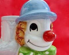 Colourful Clown (Pufalump) Tags: macromondays glaze money box clown red nose blue charlie hat green smile
