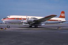 N838D-1-KFAT-APR1988 (Alpha Mike Aviation Photography) Tags: fresno airterminal fat kfat tbm tankers douglas dc7 dc7b n838d