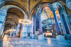 Interior columns of the Hagia Sophia located in Istanbul, Turkey. (Remsberg Photos) Tags: istanbul turkey hagiasophia column columns purple colorful chandelier light design ornate painting calligraphy islamic ceiling interior blue tones religious space construction hall tur