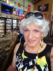 Visiting The World Of Beer (Laurette Victoria) Tags: milwaukee bar worldofbeer laurette woman silver necklace earrings