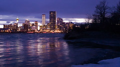 twilight raw calgary alberta canada goldenhour sunset river water skyline nightscape city view bowriver cellphonephotography cellphonecamera samsunggalaxys7 night cloudy lights citybythebow reflection springmelt ice trees silhouette spring evening urban bluehour lheurebleue