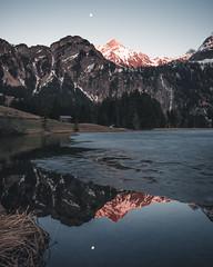 Moonrise reflection (noberson) Tags: moon moonrise reflection alps switzerland lake frozen spring glow alpenglow alpenglühen red mountain mountains lauenensee gstaad berner oberland