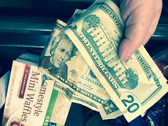 Parting with hard earned money at Whole Foods. (enovember) Tags: money cash wholefoods andrewjackson 20 twenty explore