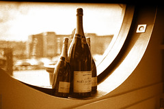 The Art of Champagne (Allan Jones Photographer) Tags: bottles champagne moet art stillart artistic champagnebottles sepia bokeh 50mm f14 allanjonesphotographer canon5d3 canonef50mmf14usm photoshop window roundwindow stilllife
