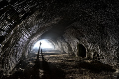 Well, I found the light at the end of the tunnel, now what? (Waving lights in the dark) Tags: testshot thelightattheendofthetunnel tunnel kiln limekiln thirds invariably nowwhat silhouette figure dark moody texture monochrome sonya7 sonyzeiss wideangle ultrawide afterdark night nightphotography