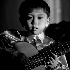 JEUNE GARCON JOUANT DE LA GUITARE,CHONGJIN,  COREE DU NORD (Eric Lafforgue Photography) Tags: school boy people blackandwhite music childhood youth square person concentration kid asia child noiretblanc guitar korea jeunesse communism learning knowledge asie lesson coree enfant personne humanbeing ecole communisme northkorea guitare dprk garcon enfance carre precocious connaissance lecon lookingatcamera instrumentdemusique blackandwhitepicture waistup squarepicture democraticpeoplesrepublicofkorea apprentissage precoce etrehumain musicintrument coreedunord rpdc chongjin regardantlobjectif republiquepopulairedemocratiquedecoree cadragealataille imagecaree ecoletchanggwang tchanggwangschool