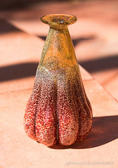 Crooked Bud Vase (Jeff Addicott) Tags: brown glass gold earthy handcrafted ruby ribbed crooked bulging artglass glassvase budvase leitzmacroelmar14100