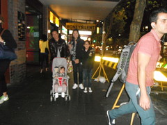 A HAPPY FAMILY (RubyGoes) Tags: trees red woman baby man girl yellow lights neon traffic pavement roadworks shops pedestrians pram darlinghurst oxfordst darlo