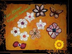 A bow , a butterfly and several flowers made with #fabric and #ribbon : all tsumami kanzashi handmade.  Un fiocco, una farfalla e tanti fiori fattai con la stoffa e nastri:tutti tsumami kanzashi fatti a mano.  Fioridoriente #handmade #flowers #fiori #fleu (fioridoriente) Tags: flowers wedding flores cute love fleur look japan butterfly handmade moda maiko fabric gift geisha bow kawaii kimono ribbon fiori giappone regalo japaneseculture idee cadeau kanzashi japanesefashion fattoamano fioridoriente
