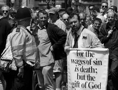 Protester (Phil Laxton Photography) Tags: street gay blackandwhite bw white black london religious death god religion protest police pride scene anti policeman 2014